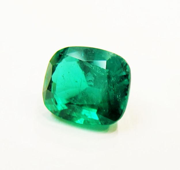 3.41 carat cushion cut Zambian emerald.
