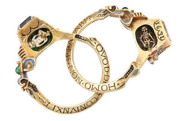 "Renaissance gimmel ring which splits apart to reveal the Latin inscription ""What God has joined let no man put asunder."" Also hidden inside are a tiny baby and skeleton, to remind the happy couple of the fleeting nature of life. We may have seen this same ring at a different  exhibition  in the past..."