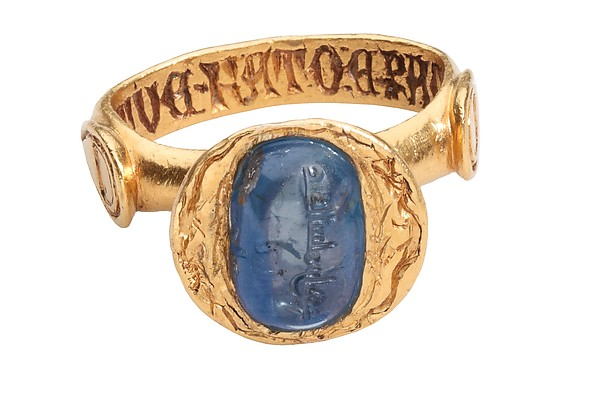 """Sapphire and Gold ring, late 14th century - sapphire 10th century. Stone is engraved in Arabic """"Abd as-Salam ibn Ahmad."""" Ring is engraved in Latin """"For love you were made and for love I wear you."""""""