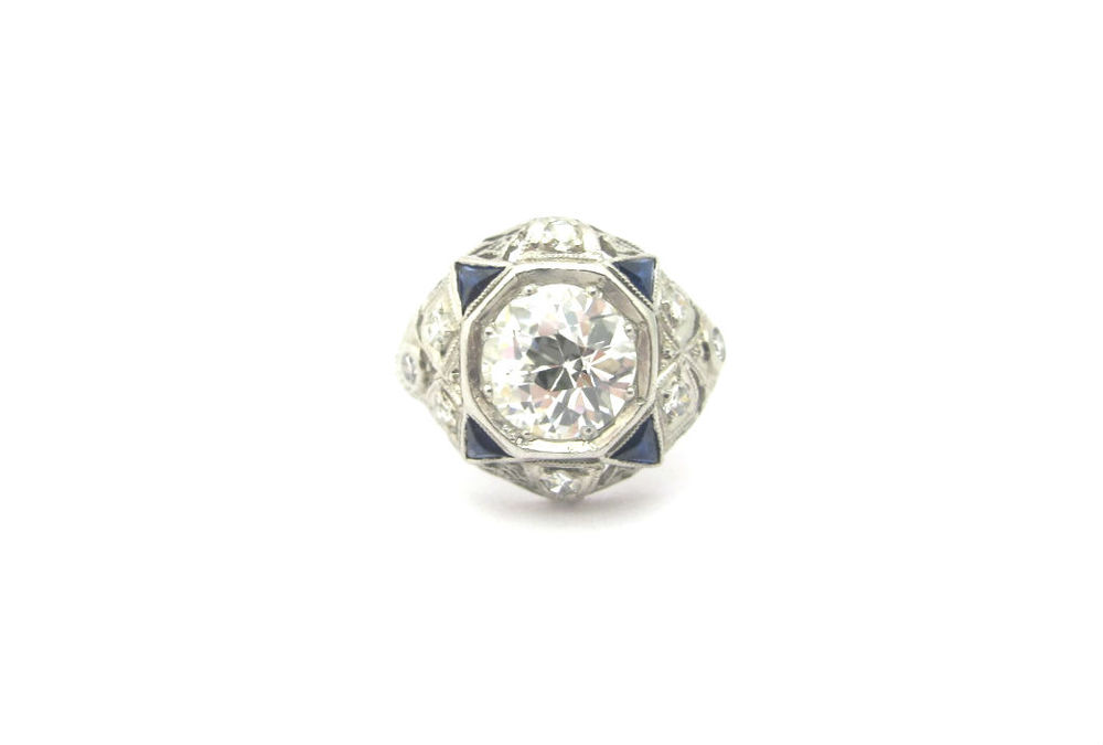 Art Deco diamond ring with 1.54 carat old European cut center and sapphire accents. Currently available in our online shop!