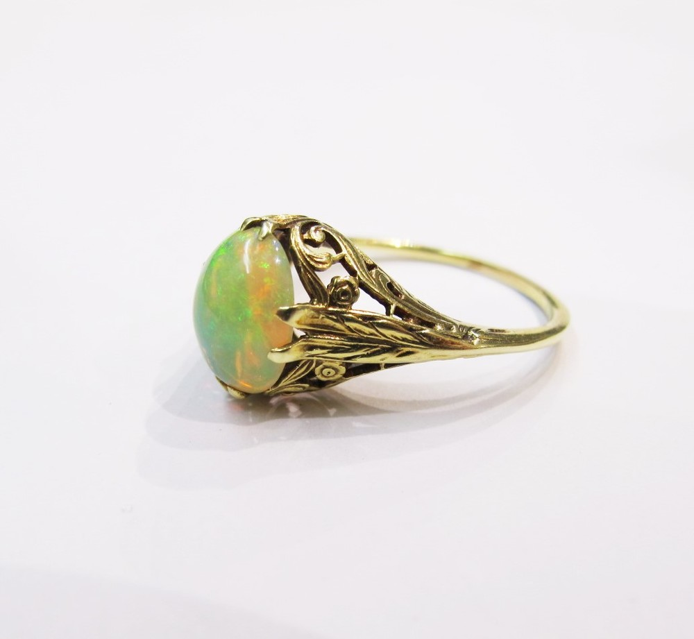 Opal cabochon set in 14k yellow gold Art Nouveau setting. c. 1910. Currently available at Gray & Davis.