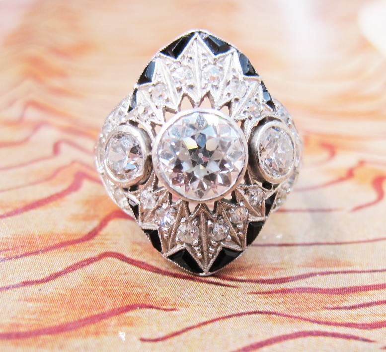 A festive, early Art Deco platinum, diamond and onyx ring. Currently available in our online shop!