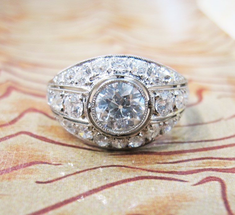An Art Deco diamond dazzler with 1ct center. Currently available in our online shop!