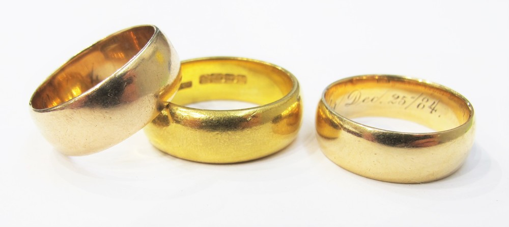 Three gold wedding rings dating c. 1890, 1870 and 1884 respectively.