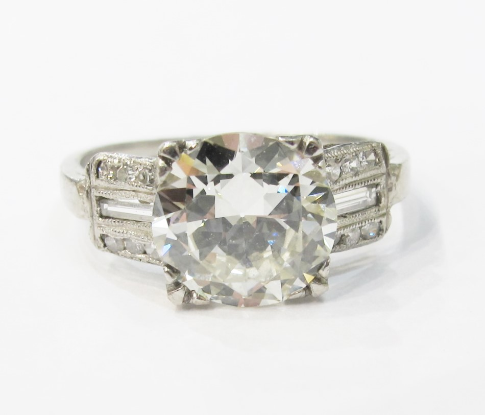 Art Deco engagement ring with baguettes, single cuts and 2.15 carat old European cut center.