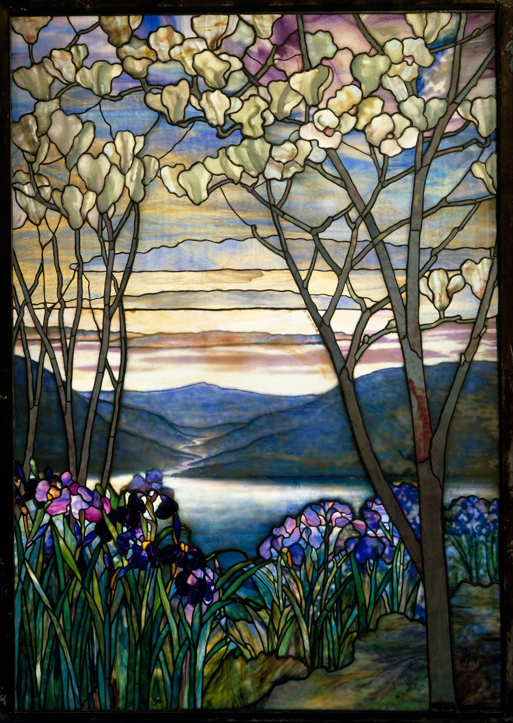 Magnolias and Irises  was designed by Louis c. Tiffany c. 1910 and originally installed in the Frank family mausoleum. Now it lives at  The Met.