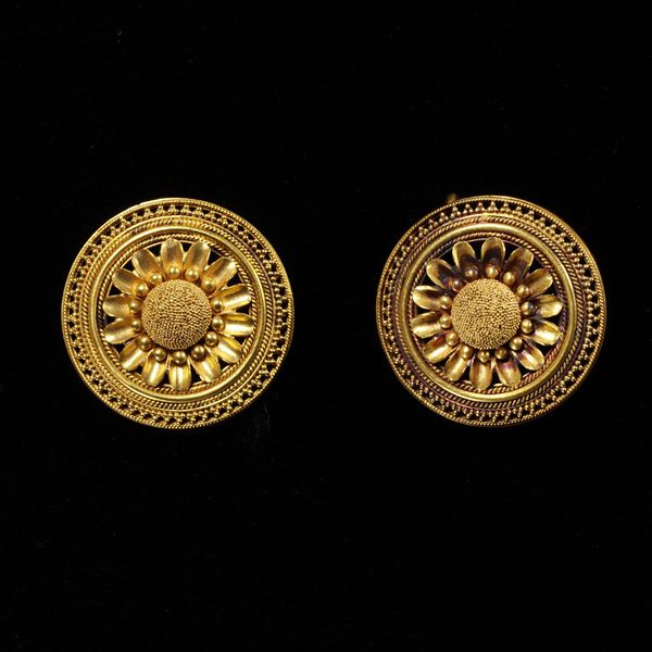 Gold earrings made by Castellani's student Carlo Giuliano c. 1865.
