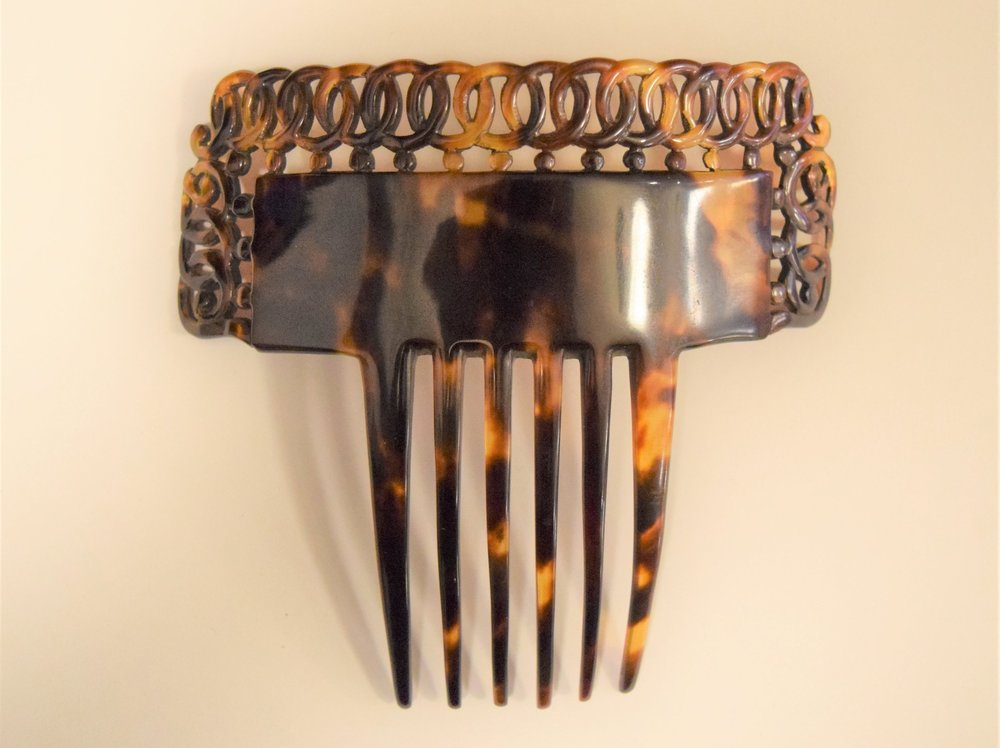 Hand carved Victorian tortoiseshell comb, made c. mid-late 19th century.