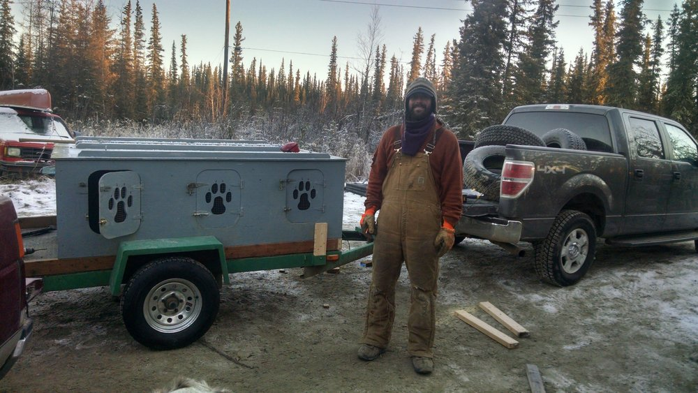 New system: Dog trailer pulled by truck.  2 sleds can be mounted on this as well as a storage container.  It now has 8 boxes.