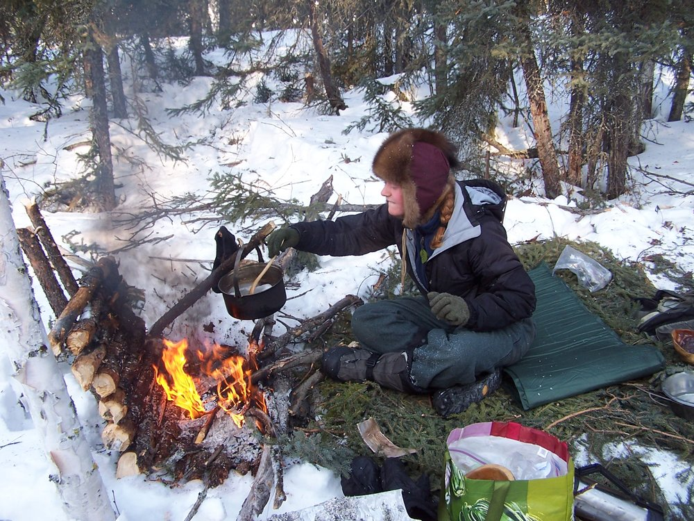 jenna cooking dinner on the trail