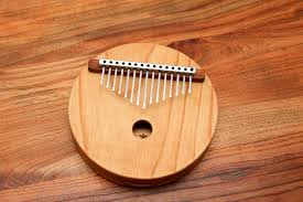 Also referred to as a thumb piano, the Kalimba consists of strips placed on a resonator. The strips come in varied lengths. A sound is produced by plucking the ends of the flexible strips. The original Kalimba was made from bamboo strips. However, modern instruments come with metal strips. The resonator is made from wood. It is popularly found in West and Central Africa.