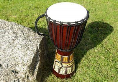 The Djembe or jembe is a type of drum found in Central and West Africa. It consists of animal skin or hide stretched over a carved piece of wood. A hole is carved out in the upper region of the wood where the skin is stretched out. The top surface is usually wider than the bottom surface