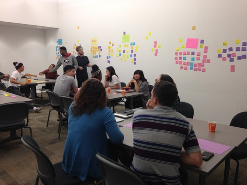 We hosted a community charrette where we asked non-art students and art students to come together and brainstorm on the wall about the greater problems of the art school and college education.