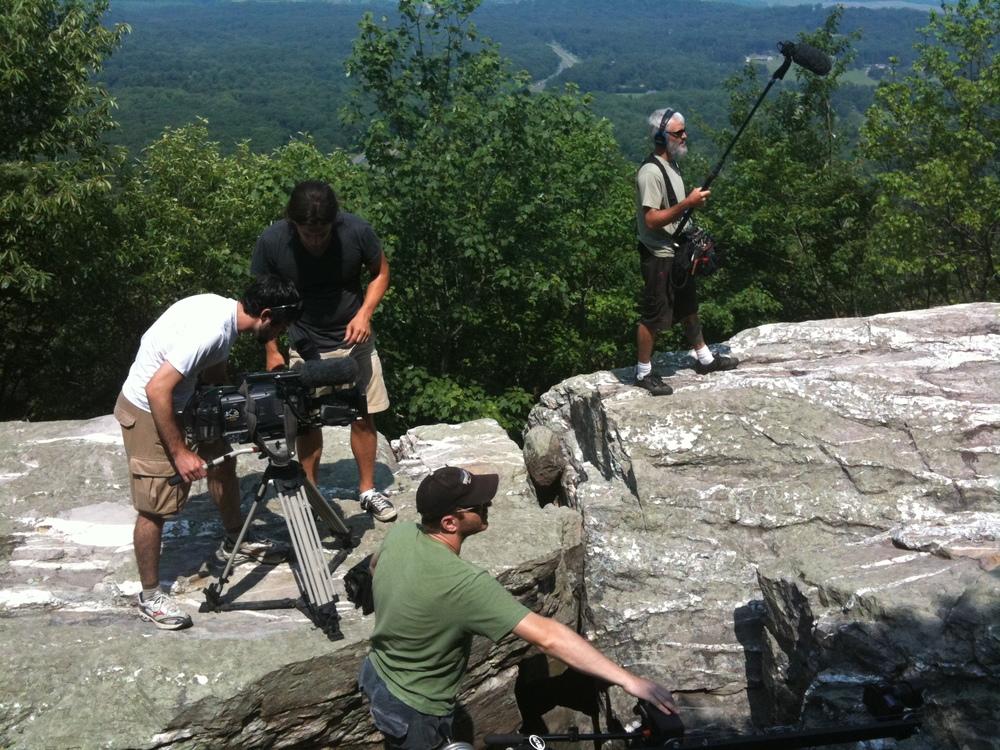 Crew_FilmingOnRocksCool2.JPG