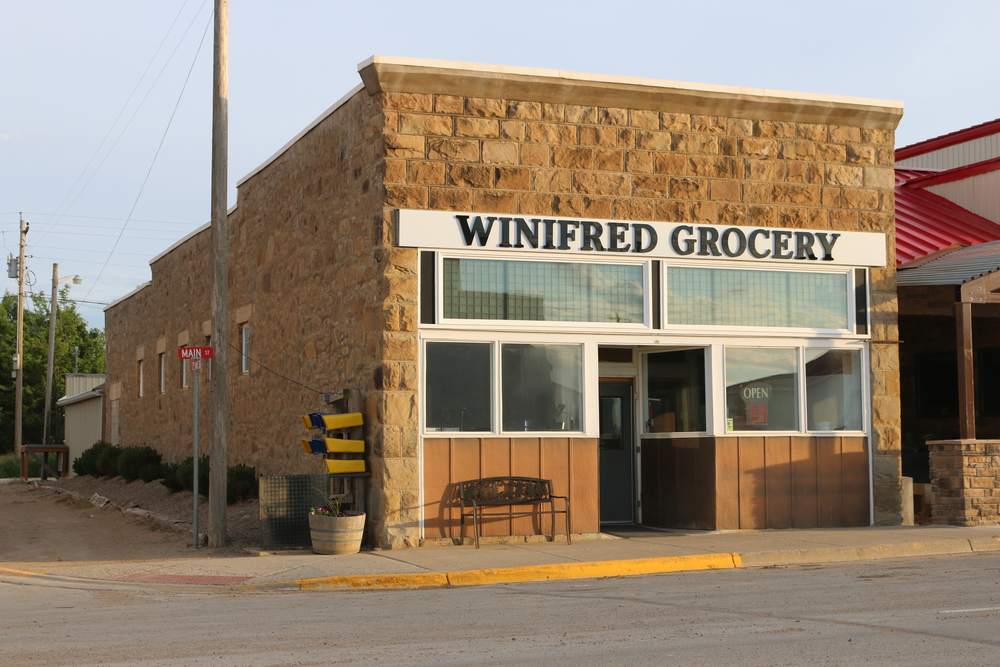 While many small towns face the prospects of shrinking inventories in their local grocery stores, Winifred Grocery has set out to defy the odds by providing an ever-expanding inventory of groceries, produce, household items, beverages, milkshakes, ice cream, beer and wine, and liquor, as well as offering fresh sandwiches and baked good in their deli.