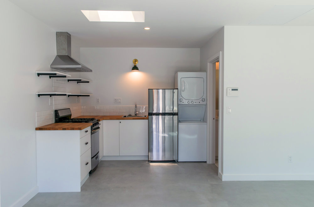 All amenities are provided in the small kitchen, including a refrigerator, stove/ oven and washer/ dryer.
