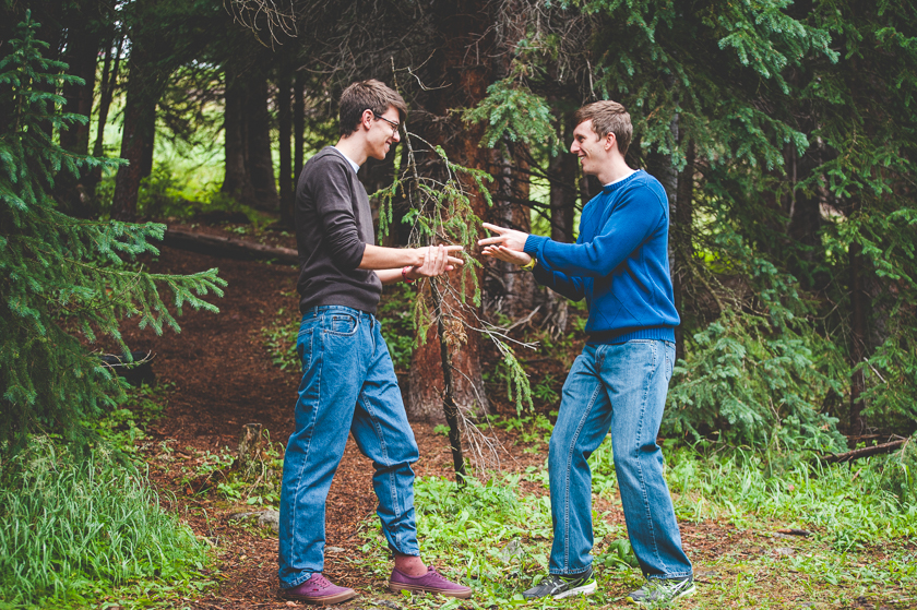 Brothers face off in a game of rock, paper, scissors during their family photo shoot at Copper Mountain Resort, near Breckenridge, Colorado.