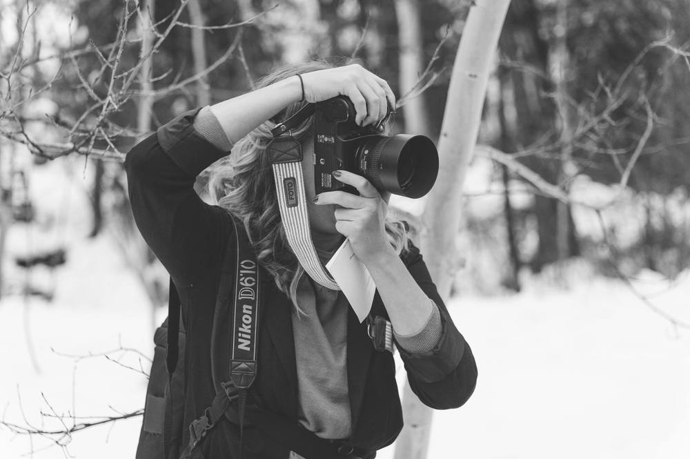 Photographer in action: photographing a winter wedding in Beaver Creek.
