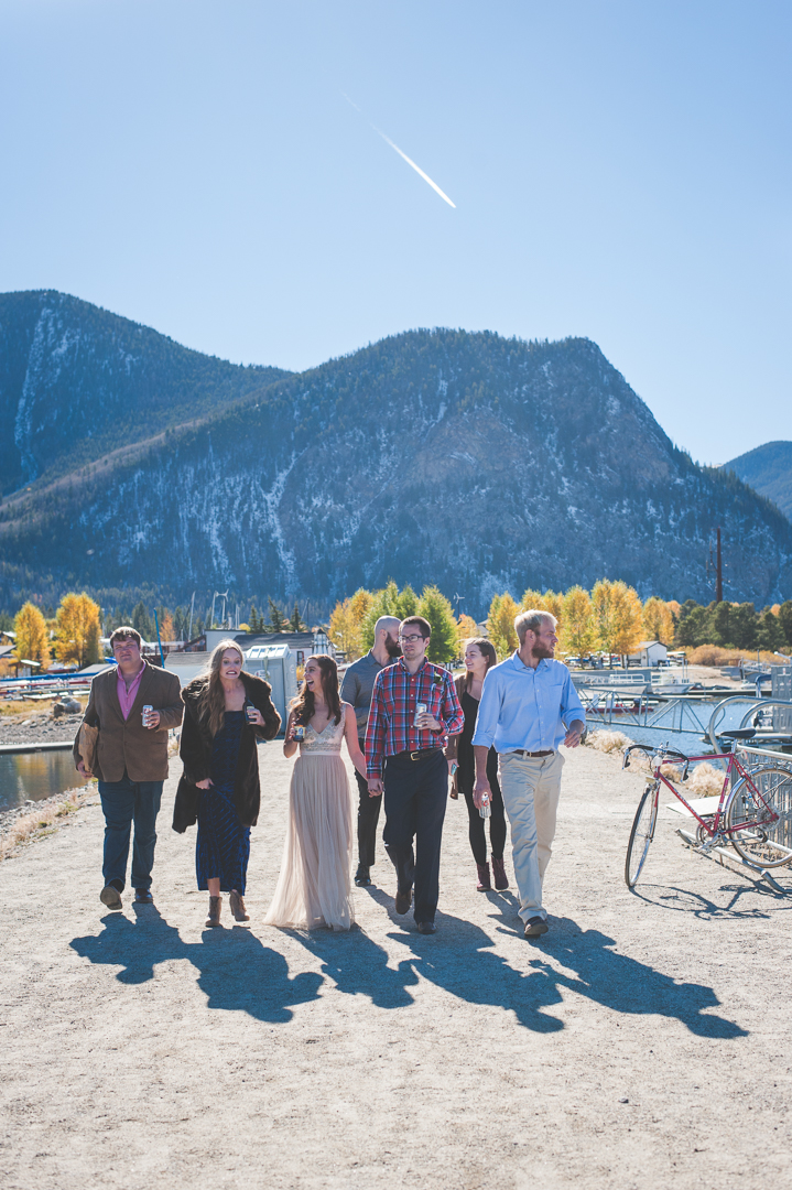 Bride, groom and their closest friends head to the Frisco Marina after a sweet and intimate elopement in the Colorado Rocky Mountains! | Keeping Composure Photography