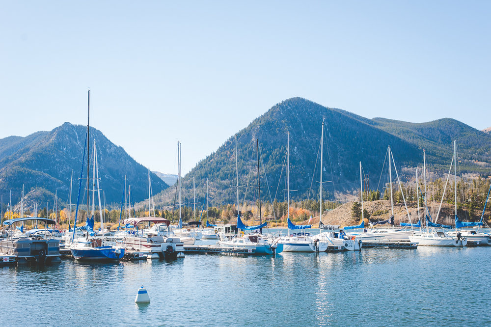 The Frisco Marina in Colorado is about as scenic a little area in the heart of the Rocky Mountains as you can find. Yellow autumn leaves still linger at the base of the mountains, and sail boats sway in the lake waiting for the winds to pick up. | Keeping Composure Photography
