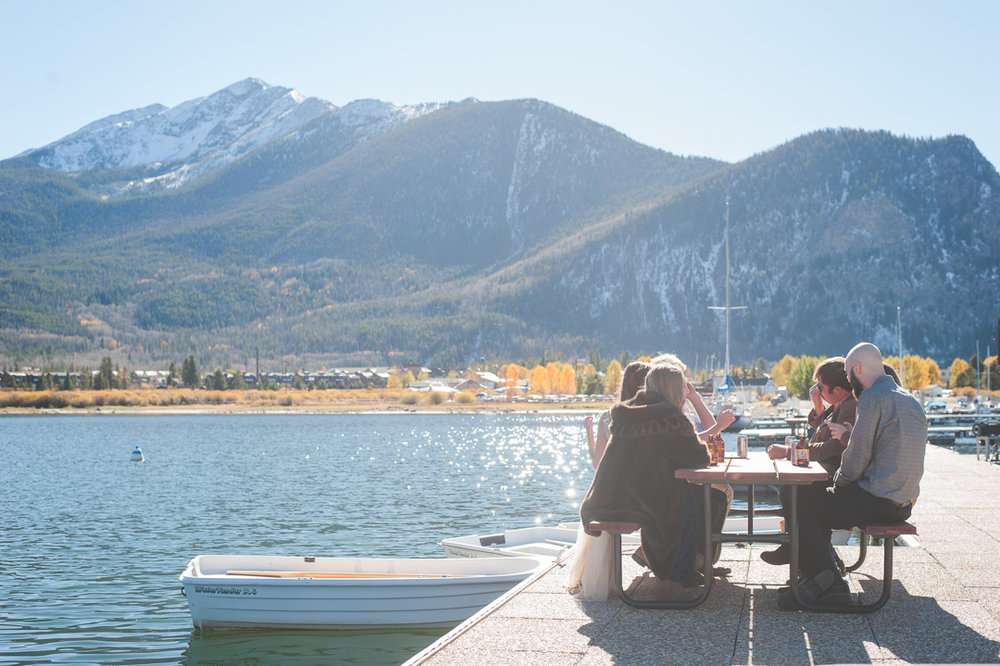 A snowy-topped Peak One stands tall over Lake Dillon, as the intimate party moved to the docks a the Frisco Marina. Champagne, laughter and a cool autumn breeze filled the afternoon. | Keeping Composure Photography