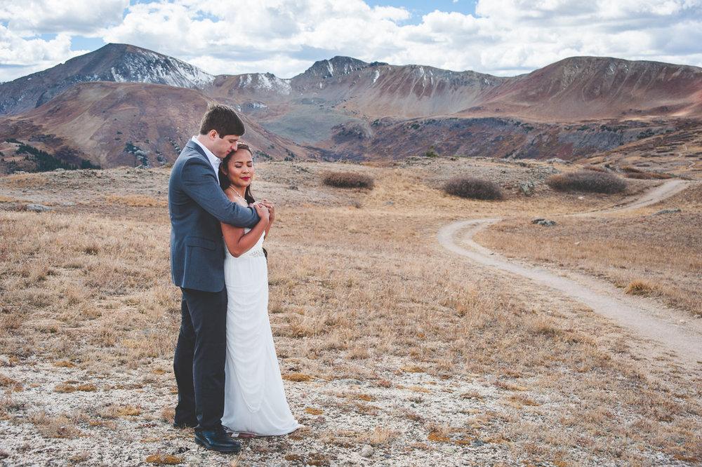 Colorado bride and groom embrace on the top of Independence Pass, near Aspen, Colorado. | Keeping Composure Photography