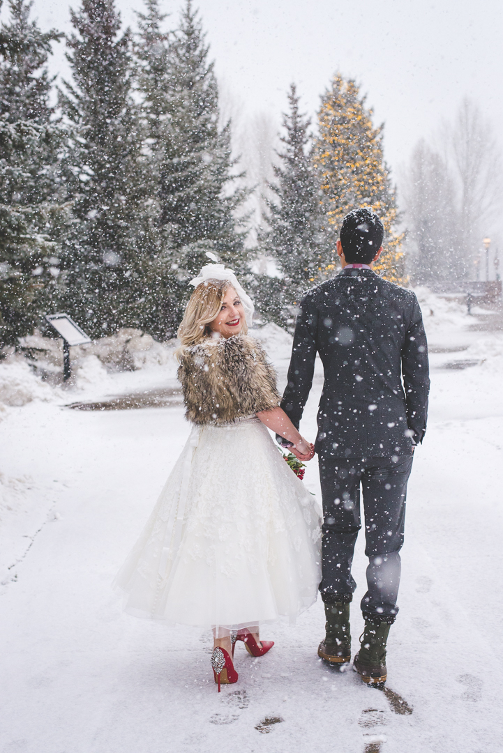 Fur shawl, red lips, red shoes and a perfect tea-length wedding dress complete the bride's look for her destination winter elopement in Breckenridge, Colorado. | Keeping Composure Photography