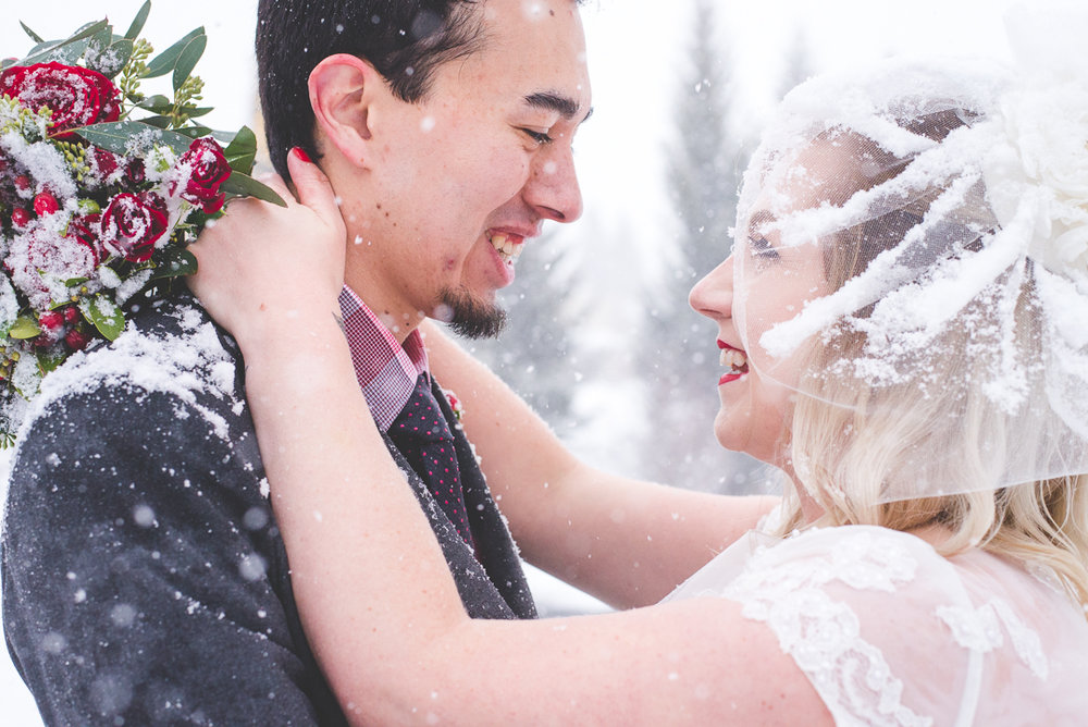 Snow! This winter elopement got the true Colorado treatment - tons of falling snow in the middle of their outdoor ceremony in Breckenridge. Beautiful destination elopement. | Keeping Composure Photography