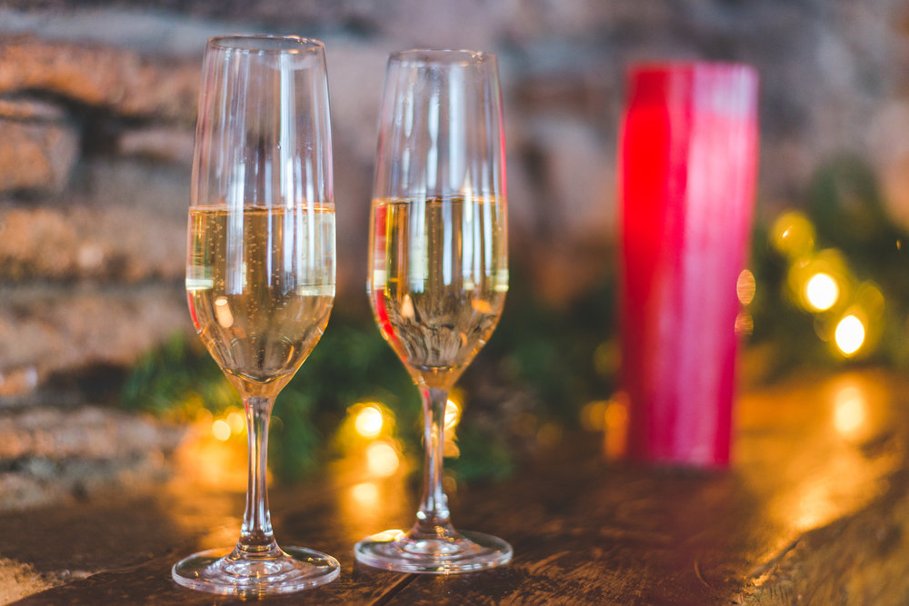 champagne toast ready on the holiday mantel at new years eve