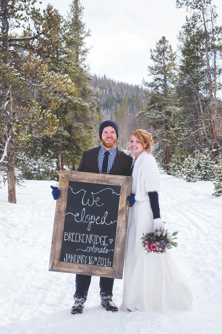 this colorado bride created her own chalkboard sign to commemorate their elopement in breckenridge.