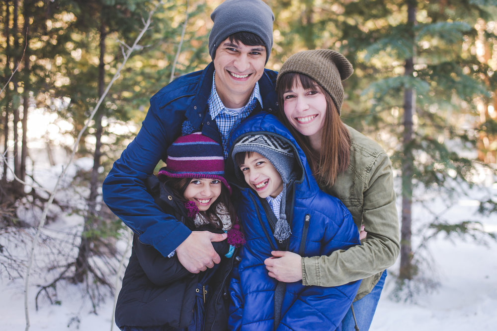 all bundled up and hugs for days - this is such an adorable family photo from our session in Frisco, Colorado.
