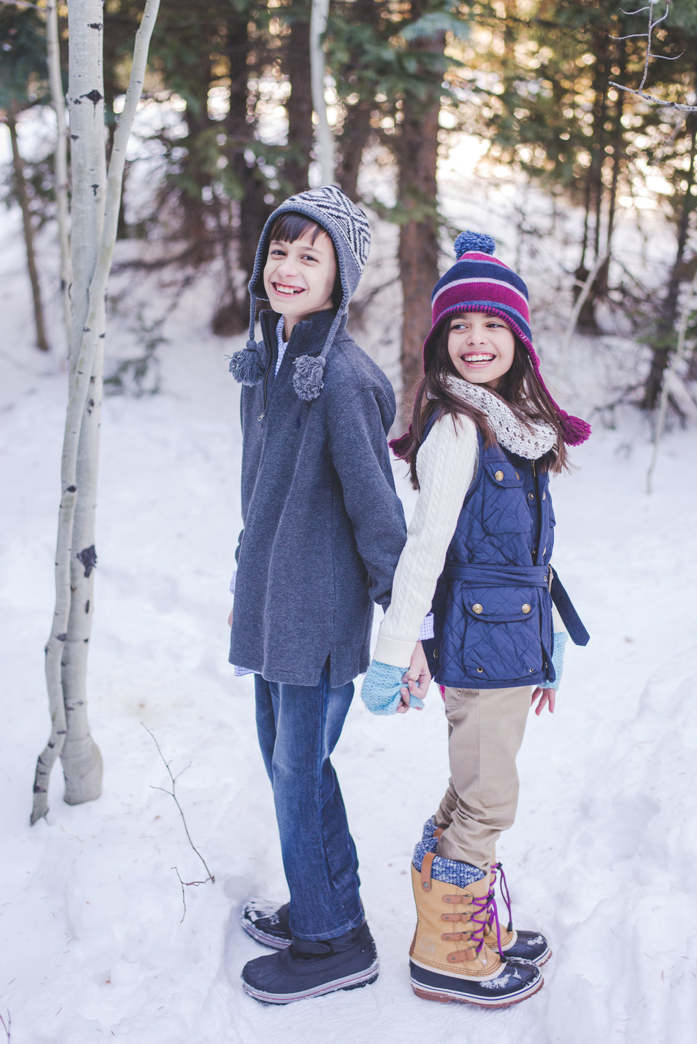 winter style for these kids is on point! cute hats, winter boots, knit gloves and smiles for days! even in the middle of winter, you can still dress for success for your family photos!