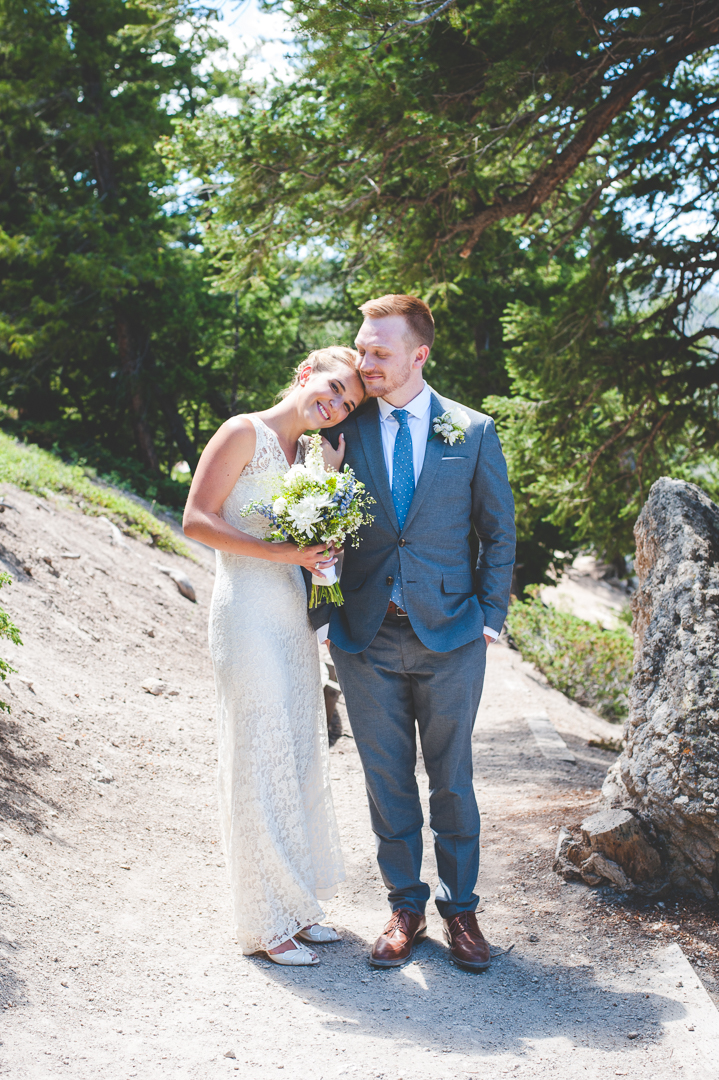 colorado bride cuddles up to her new husband after their Sapphire Point wedding ceremony in June