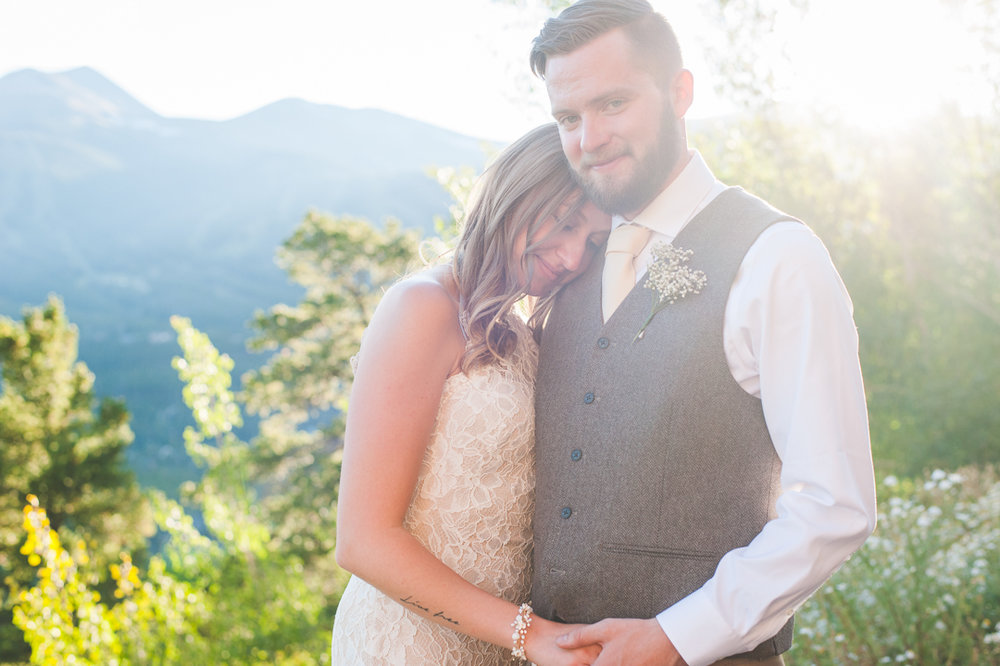 gorgeous afternoon light spills over these two newlyweds during photos at The Lodge at Breckenridge
