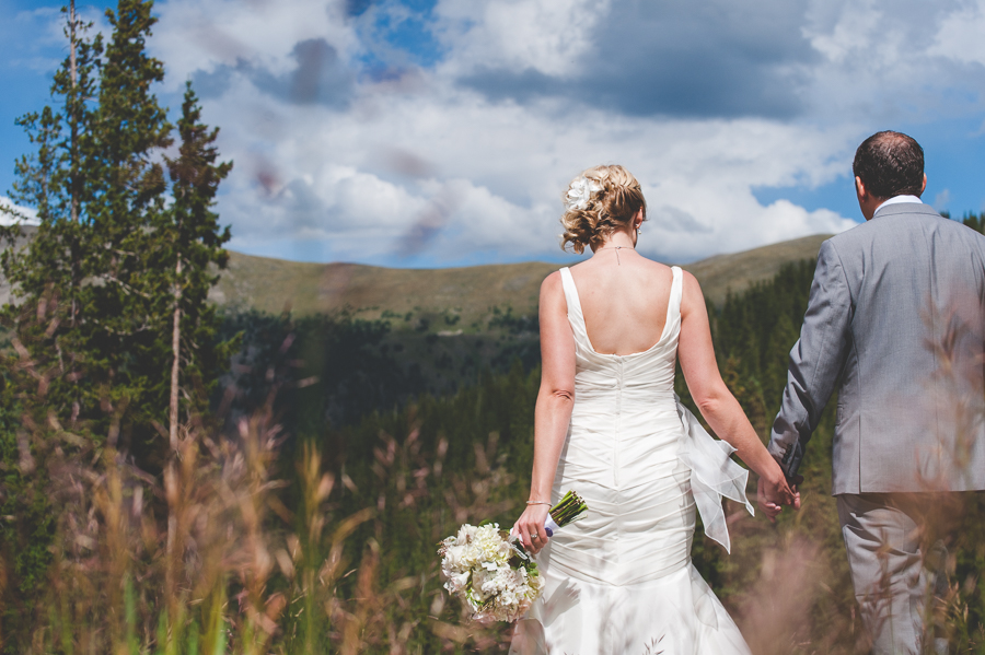 heading into their next amazing adventure hand in hand after this couple's beautiful wedding at Solitude Station in Copper Mountain, Colorado