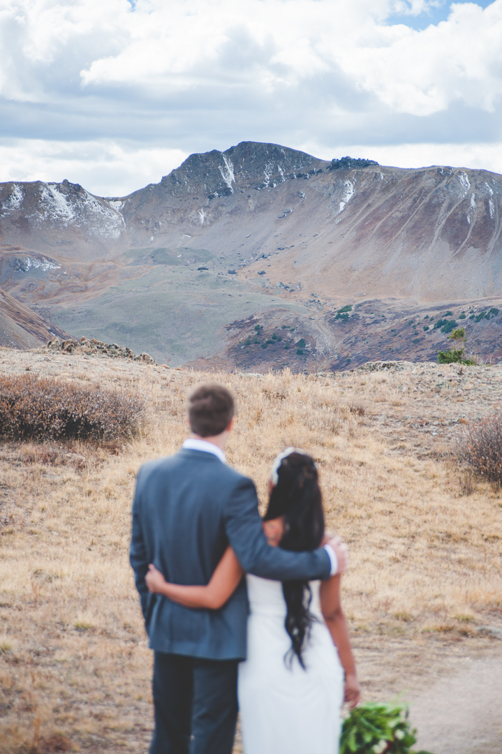 views at the top of Independence Pass near Aspen, Colorado are stunning; this Colorado bride and groom take it in