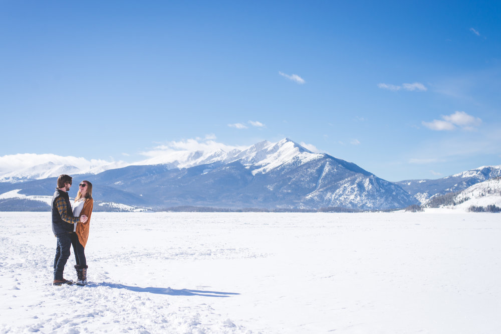engagement photos on frozen lake dillon with Peak One in the background. colorado engagement