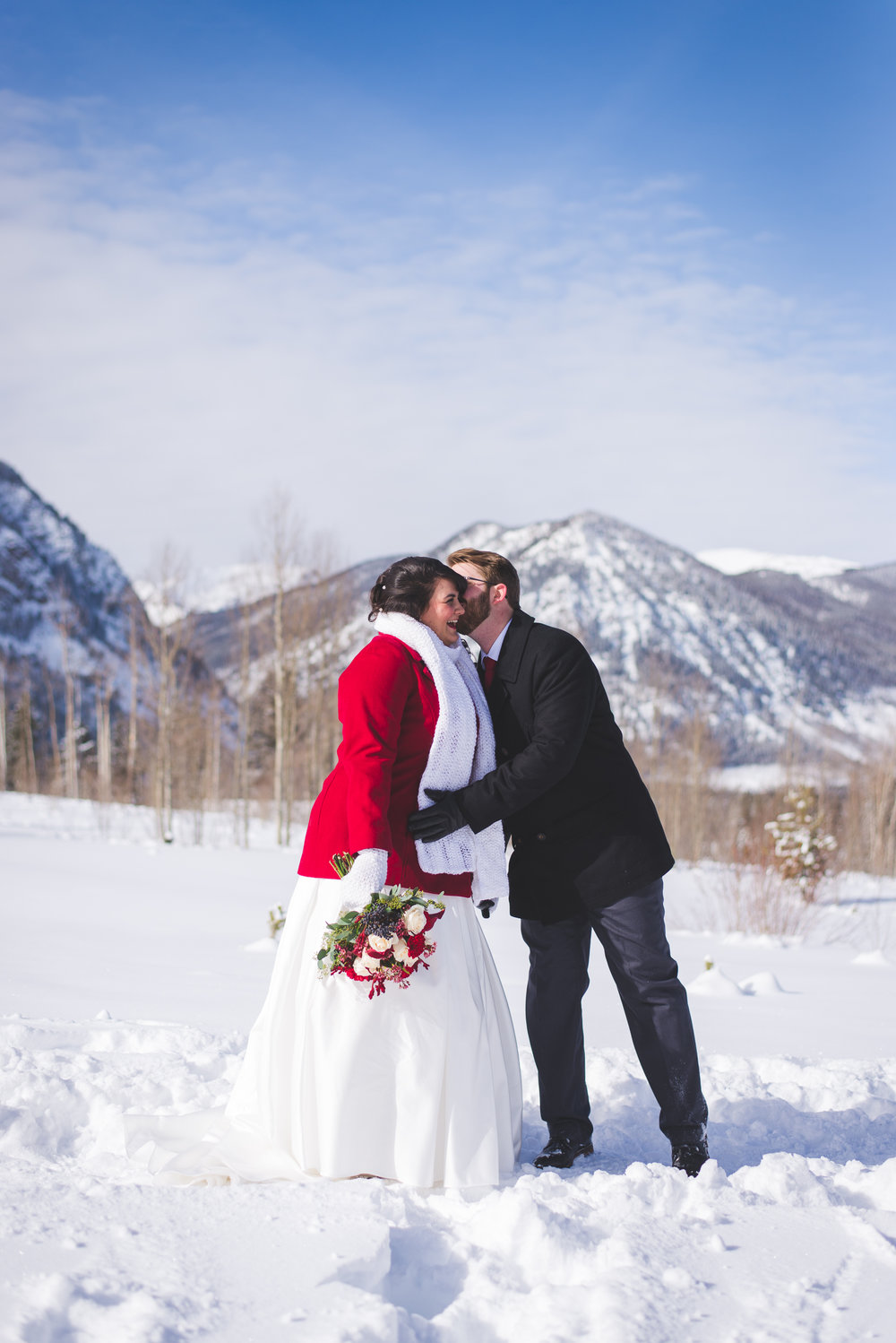 The snow covered mountains in Frisco, Colorado set the backdrop for a beautiful elopement