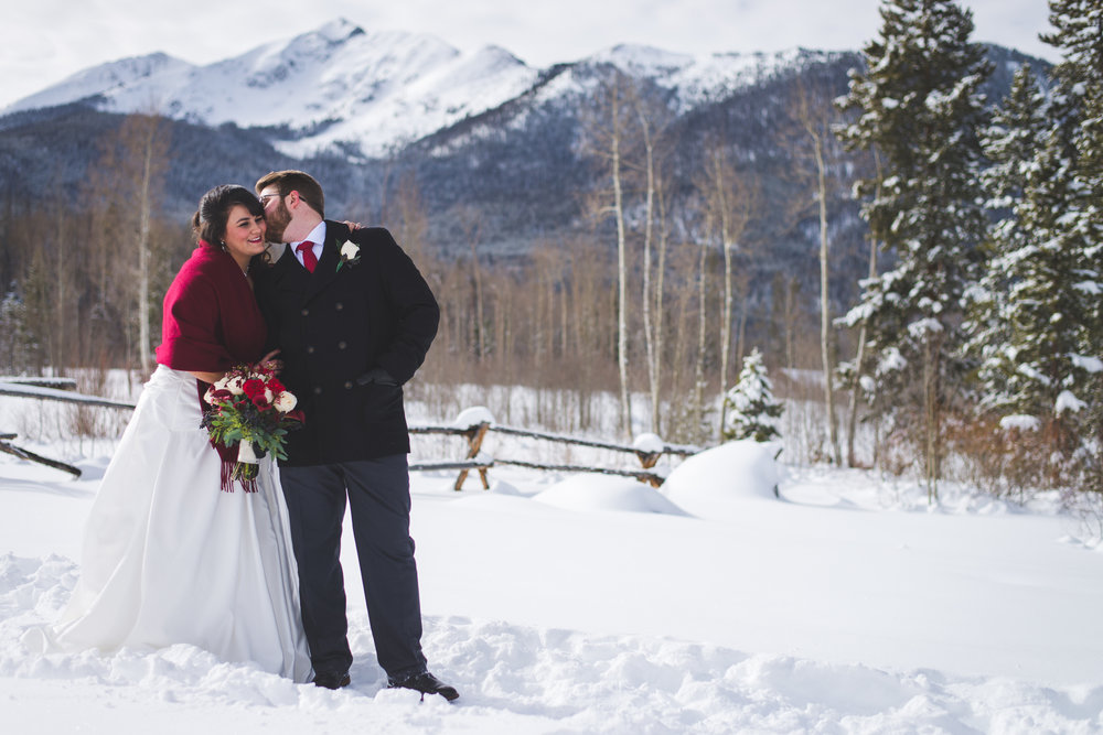 A Colorado bride and groom, snowy Peak One in Frisco, Colorado and a gorgeous winter bride and groom complete the look for this destination elopement.