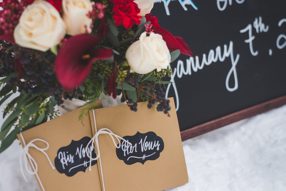 Sweet, little details make a big difference for weddings - like these little vow book, a commemorative chalkboard and a beautiful winter bouquet.