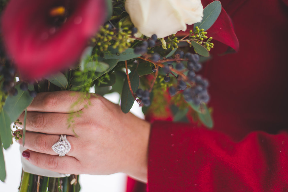 This bride's pear-shaped engagement ring and matching band is absolutely stunning!