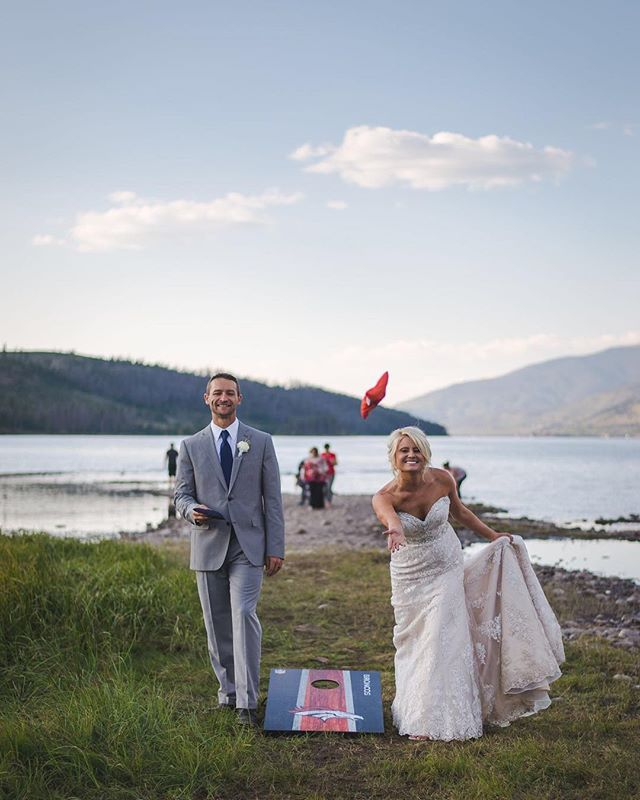 When the bride interrupts your family game of corn hole to throw a few herself, you hand over the bags! That's what these two did when we headed lakeside for dusk photos. A little playtime after a long {amazing!} day.