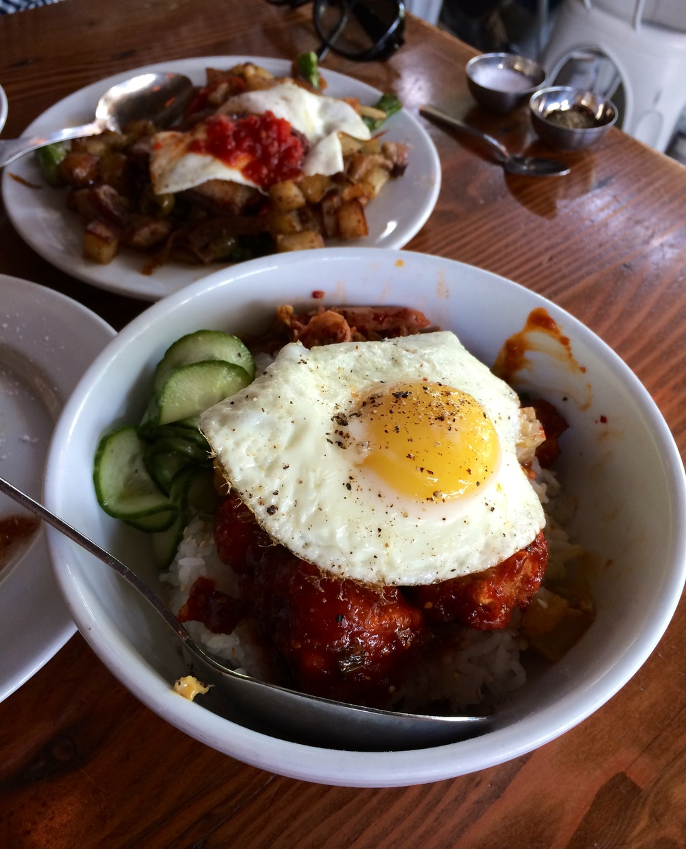 Korean Fried Chicken with rice, kimchi, and egg.