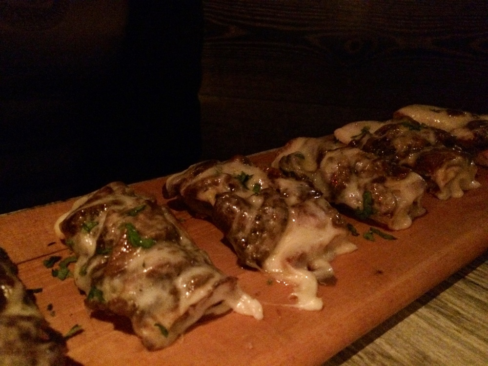 BRUSCHETTA TOPPED WITH MUSHROOMS, CHEESE, AND TRUFFLE OIL