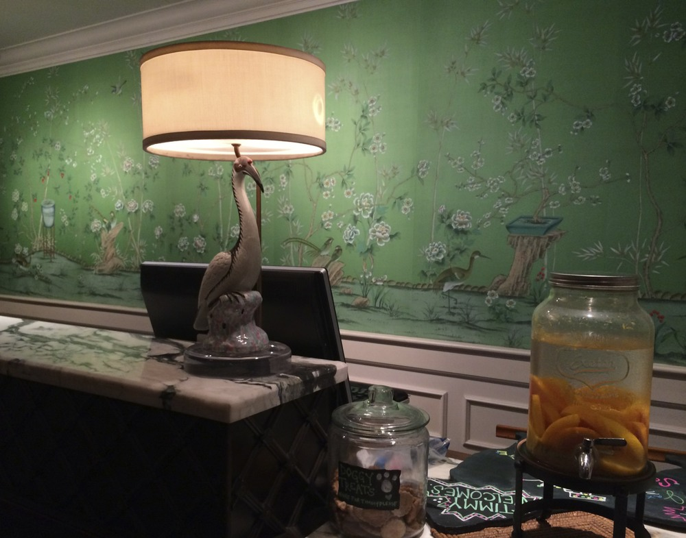 Love the wallpaper behind the check-in desk.