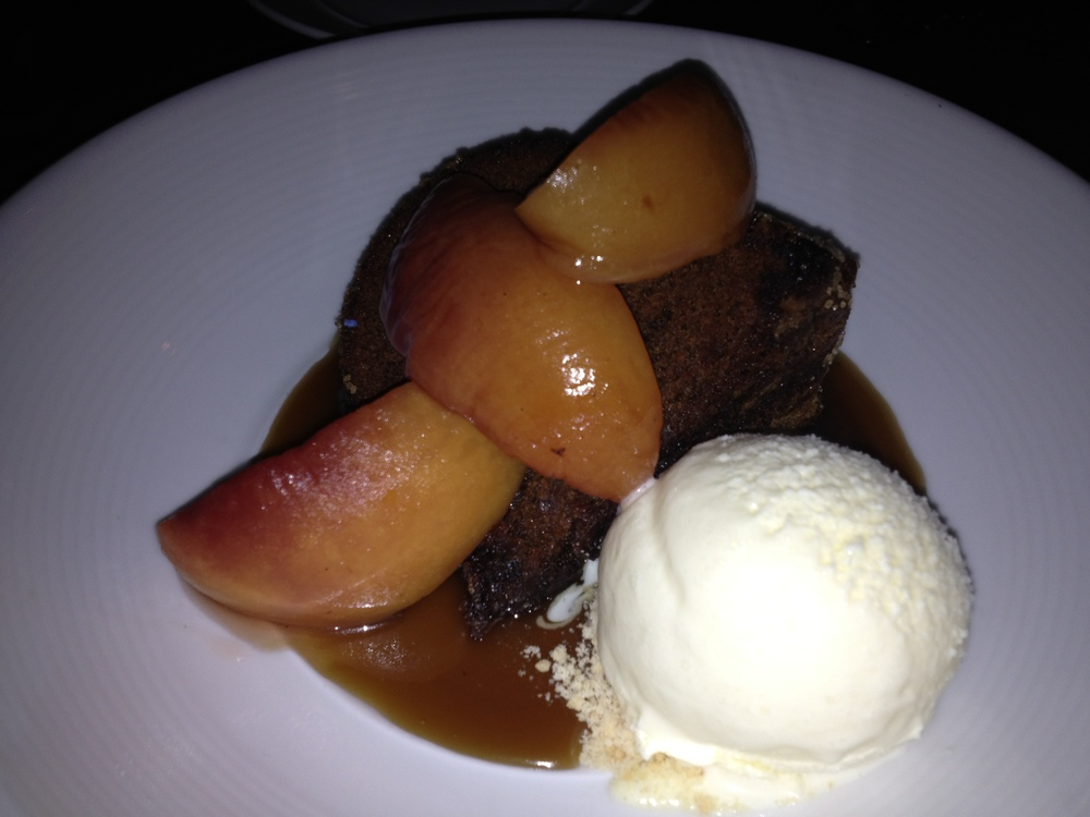 GINGER STOUT CAKE WITH ROASTED PEACHES AND HONEY ICE-CREAM.