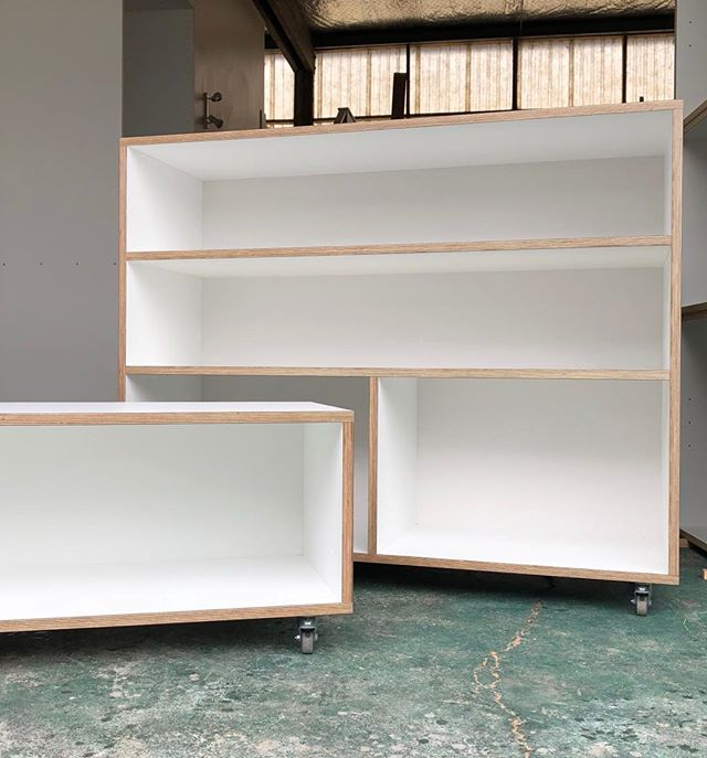 Two custom built mobile shelving units, giving versatility to the clients chosen space.