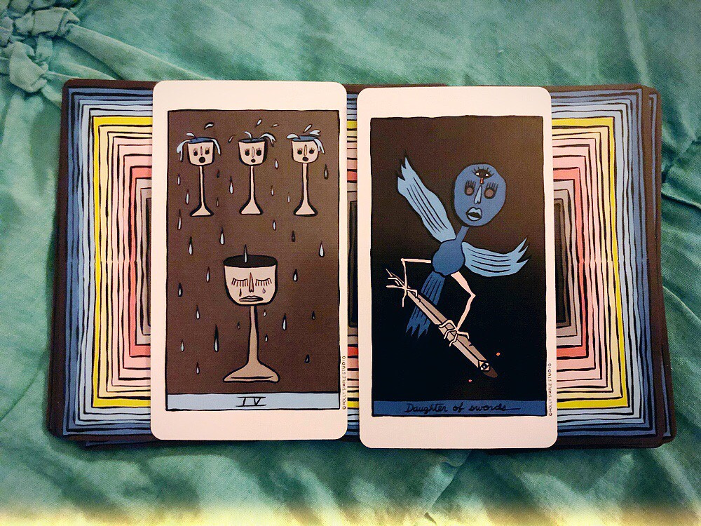 Energy: Four of Cups | Advice: Daughter of Swords