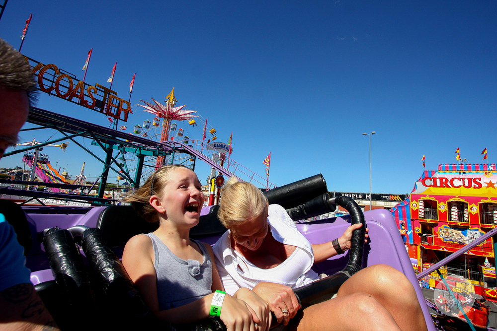 Alicia Winter, 10, and her mum Ann Winter are enjoying themselves on the Crazy Coaster ride at the Brisbane Ekka.
