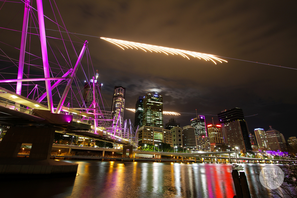 Two Super Hornets fly past the city skyline at the start of Riverfire.